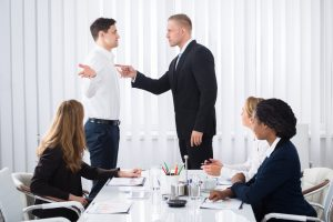 15961400-businessman-blaming-his-colleague-in-meeting